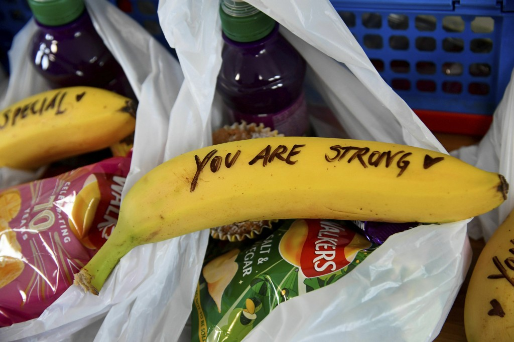 In this Friday, Feb. 1, 2019 photo, messages written on bananas by Meghan, the Duchess of Sussex as she helped to prepare food parcels to be dispatche