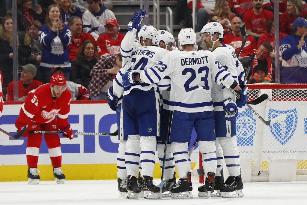 Toronto Maple Leafs center Auston Matthews (34) celebrates his goal against the Detroit Red Wings in the second period of an NHL hockey game, Friday, ...
