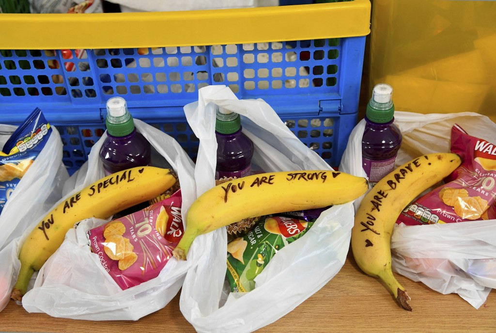 In this Friday, Feb. 1, 2019 photo, messages written on bananas by Meghan, the Duchess of Sussex as she helped to prepare food parcels to be dispatche...