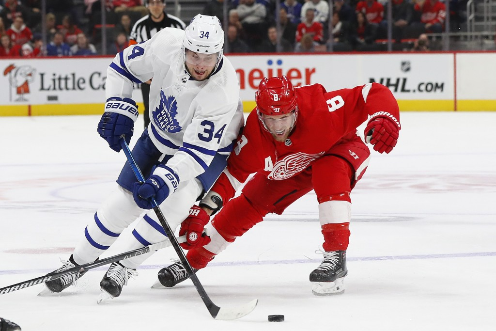 Toronto Maple Leafs center Auston Matthews (34) skates around Detroit Red Wings left wing Justin Abdelkader (8) in the first period of an NHL hockey g...