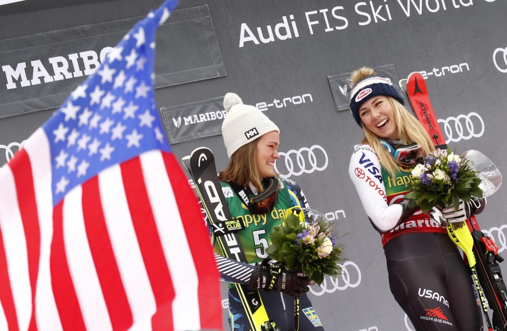 United States' Mikaela Shiffrin, right, winner of an alpine ski, women's World Cup slalom, celebrates on the podium with second-placed Sweden's Anna S...