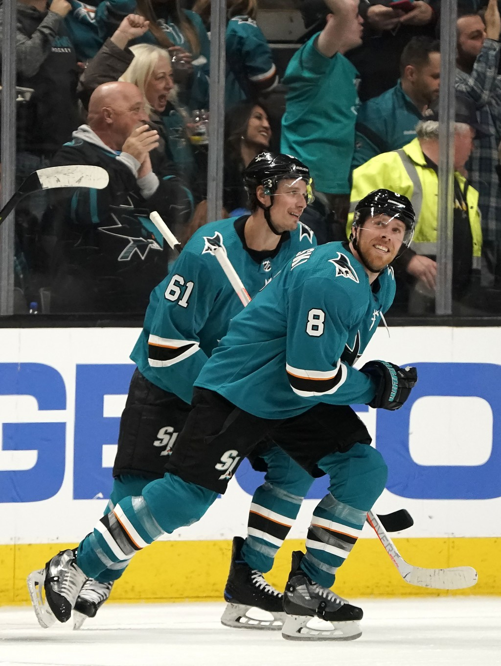 San Jose Sharks center Joe Pavelski (8) smiles after scoring a goal against the Arizona Coyotes during the second period of an NHL hockey game in San