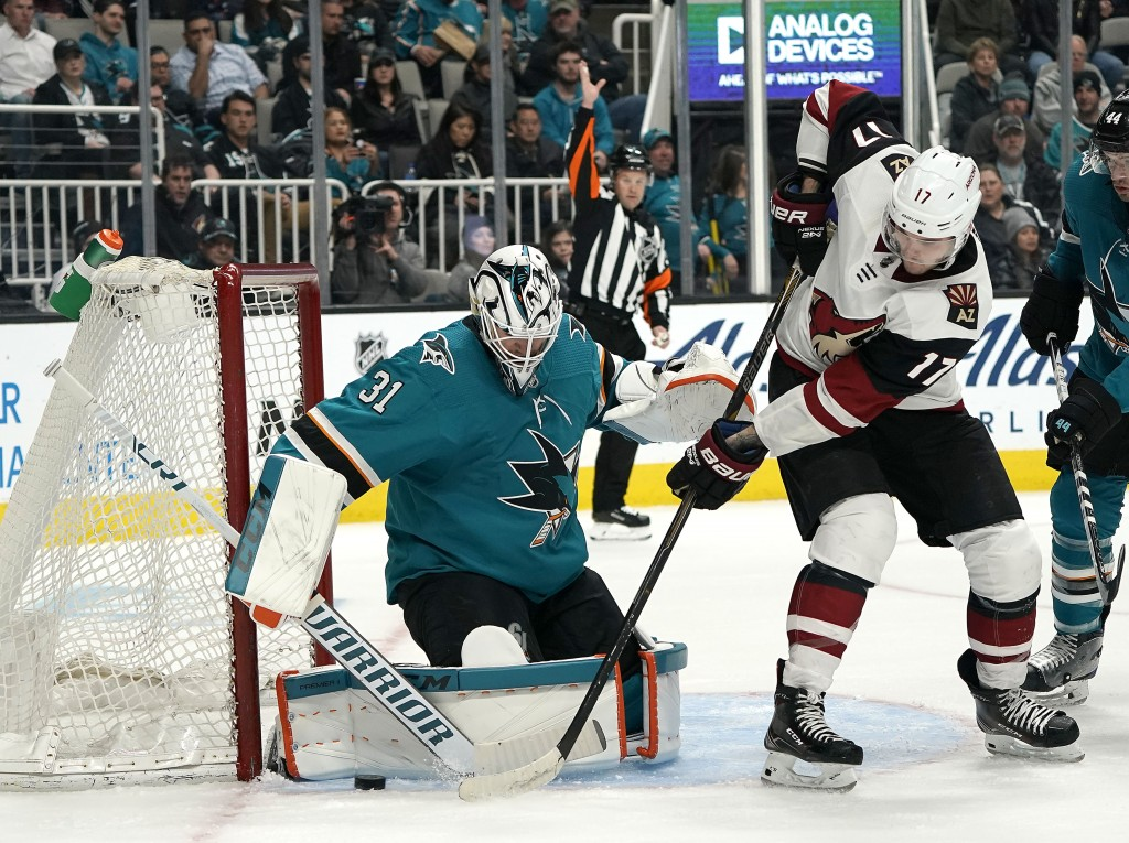 San Jose Sharks goaltender Martin Jones (31) blocks a shot from Arizona Coyotes center Alex Galchenyuk (17) during the second period of an NHL hockey