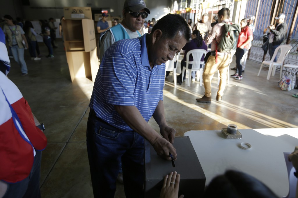 A man casts his vote during the presidential election at a polling station in San Salvador, El Salvador, Sunday, Feb. 3, 2019. Salvadorans are choosin
