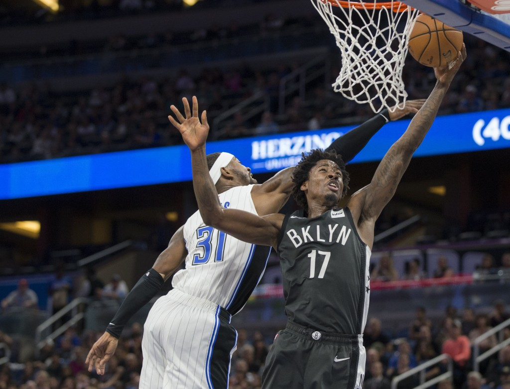Brooklyn Nets center Jarrett Allen (31) lays the ball up as Orlando Magic guard Terrence Ross (31) defends during the first half of an NBA basketball ...