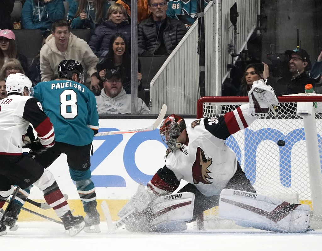 San Jose Sharks center Joe Pavelski (8) scores a goal past Arizona Coyotes goaltender Darcy Kuemper during the second period of an NHL hockey game in