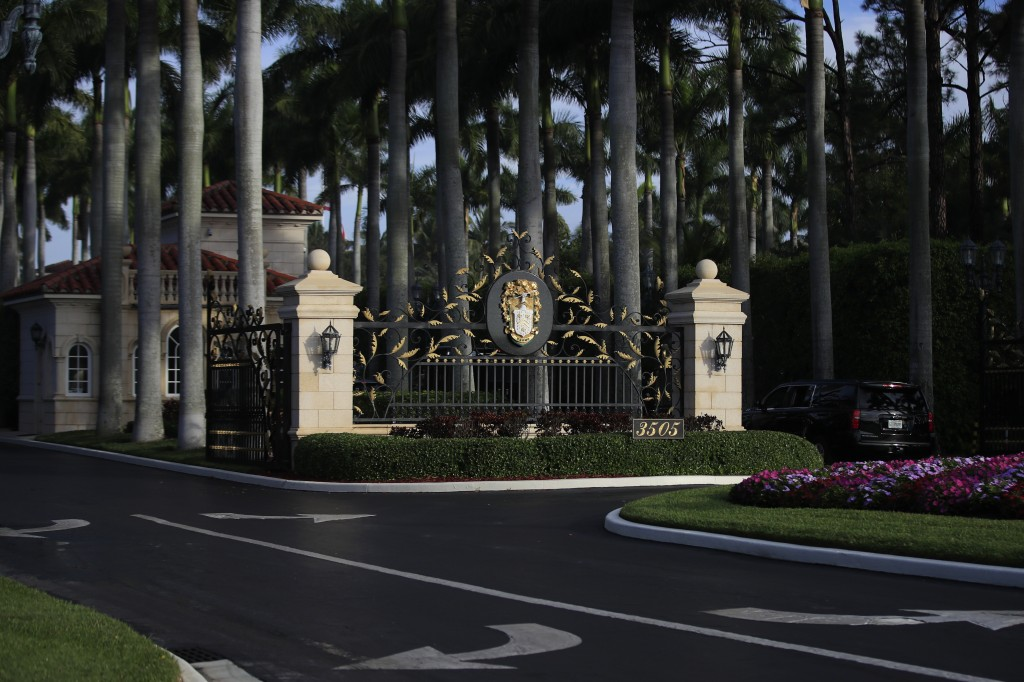 The entrance to Trump International Golf Club in West Palm Beach, Fla., is shown, Sunday, Feb. 3, 2019, as President Donald Trump's motorcade arrives.