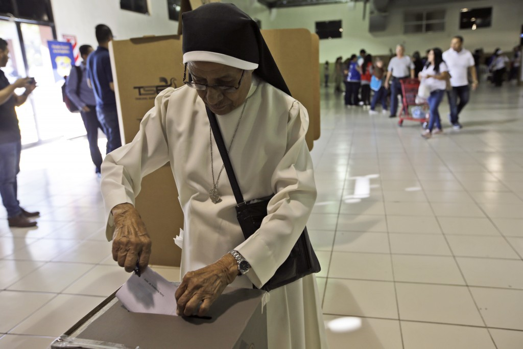 Nun Zoila Hernandez casts her vote during the presidential election at a polling station in San Salvador, El Salvador, Sunday, Feb. 3, 2019. Salvadora