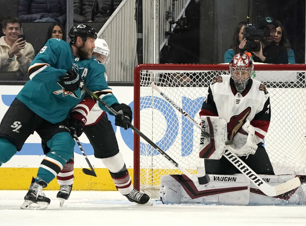 Arizona Coyotes goaltender Darcy Kuemper (35) blocks a shot from San Jose Sharks center Joe Thornton (19) during the second period of an NHL hockey ga