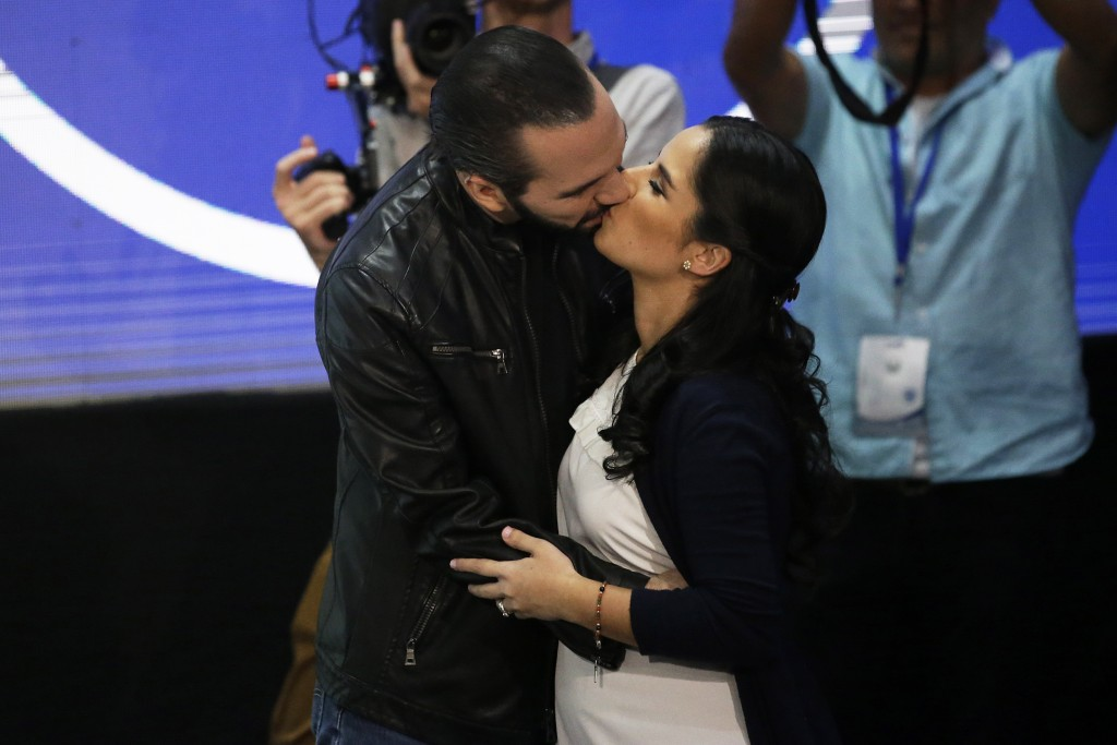 Presidential frontrunner Nayib Bukele, of the Grand Alliance for National Unity, kisses his wife Gabriela before giving a press conference, in San Sal