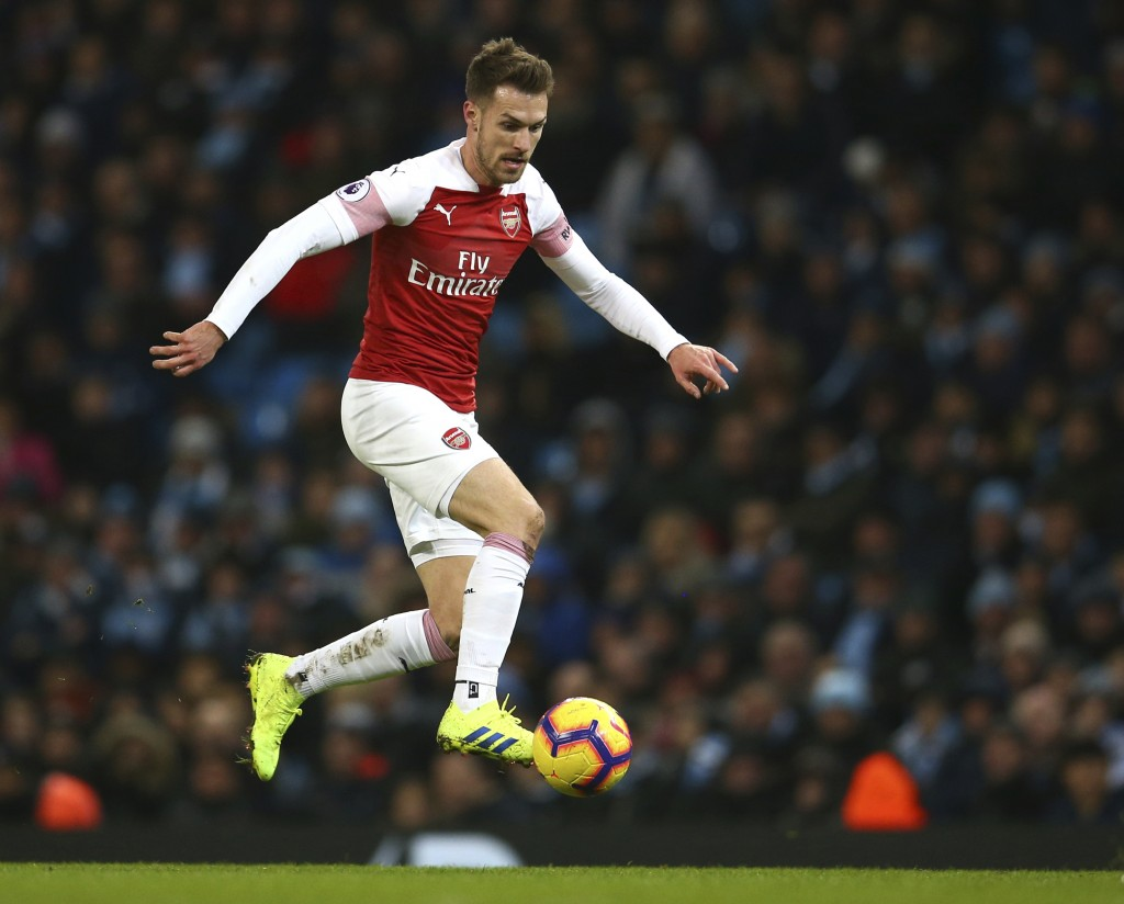 Arsenal's Aaron Ramsey controls the ball during the English Premier League soccer match between Manchester City and Arsenal at Etihad stadium in Manch...