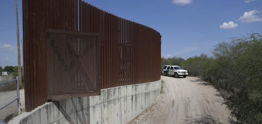 FILE - In this Aug. 11, 2017, file photo, a U.S. Customs and Border Patrol vehicle passes along a section of border levee wall in Hidalgo, Texas. The ...