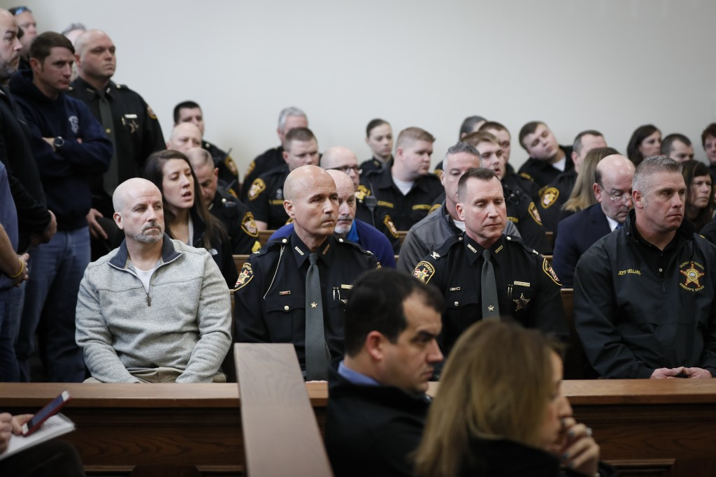 Clermont County Deputy Lt. Nick DeRose, left, and Sheriff Robert S. Leahy, center left, attend a hearing for suspect Wade Edward Winn at Clermont Coun...