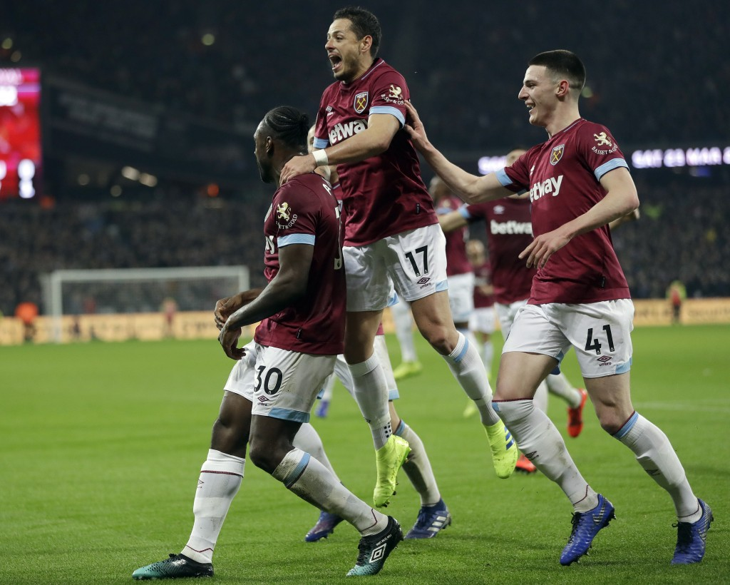 West Ham's Michail Antonio, left, celebrates with West Ham's Chicharito, centre, and West Ham's Declan Rice after scoring his side's first goal during