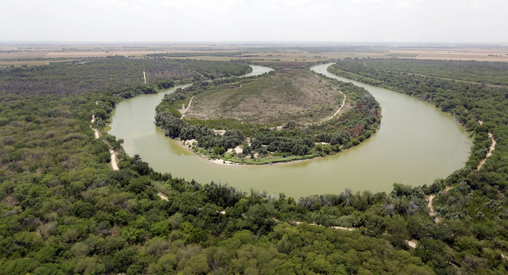 FILE - In this July 24, 2014, file photo, a bend in the Rio Grand is viewed from a Texas Department of Public Safety helicopter on patrol over in Miss...