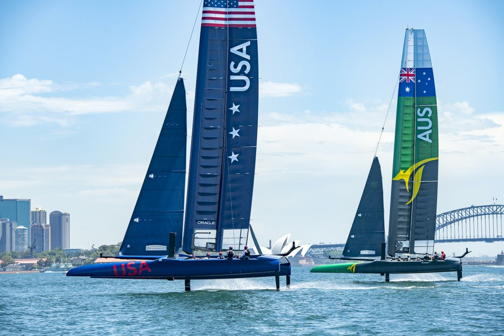 In this Sunday Feb. 3, 2019 photo provided by SailGP, SailGP USA Team, left and SailGP Australia Team practice side to side in Sydney. Taylor Canfield...