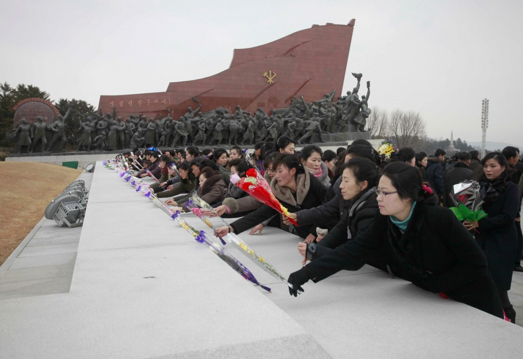 People visit statues of North Korean late leaders, Kim Il Sung and his son Kim Jong Il, to lay bouquets of flowers in Pyongyang, North Korea, on Lunar