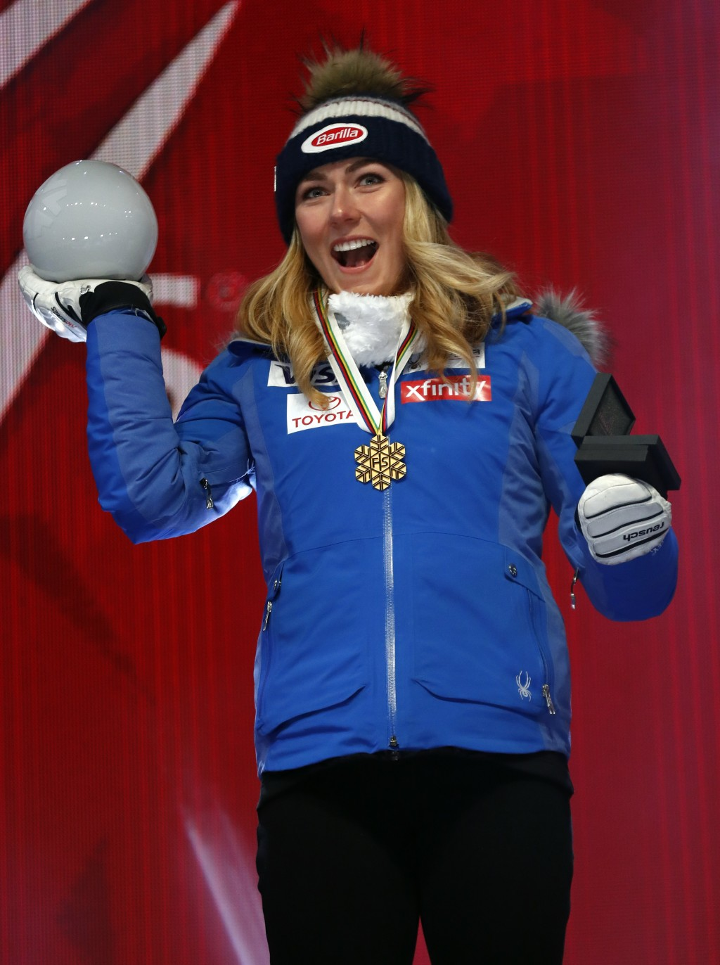 United States' Mikaela Shiffrin poses with her gold medal of the women's super-G, at the alpine ski World Championships in Are, Sweden, Tuesday, Feb. ...