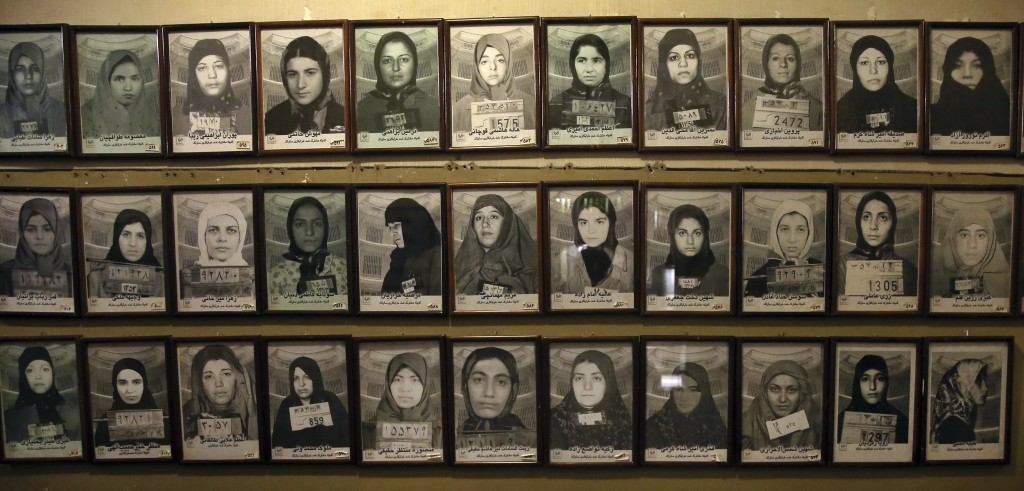 In this Monday, Jan. 7, 2019 photo, mug shots of former prisoners hang on the wall at a former prison run by the pre-revolution intelligence service,