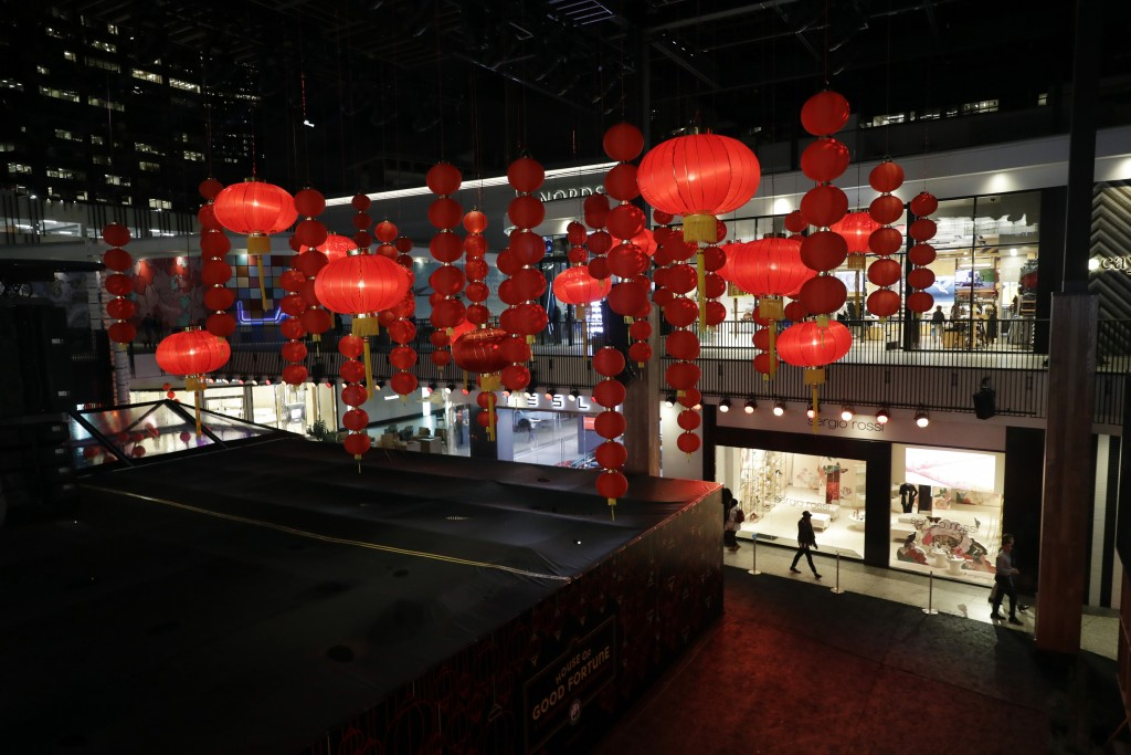 Decorations, part of a Lunar New Year installation, are placed in the main atrium of a mall Thursday, Jan. 31, 2019 in Santa Monica, Calif. In recent