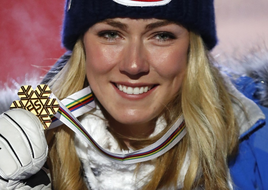 United States' Mikaela Shiffrin poses with her gold medal of the women's super-G, at the alpine ski World Championships in Are, Sweden, Tuesday, Feb.