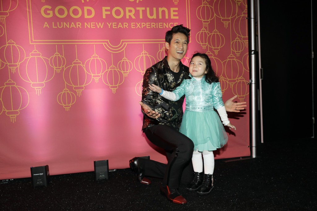 Actor Harry Shum Jr., left, poses for photos with a young fan during the opening of a Lunar New Year installation Thursday, Jan. 31, 2019 in Santa Mon