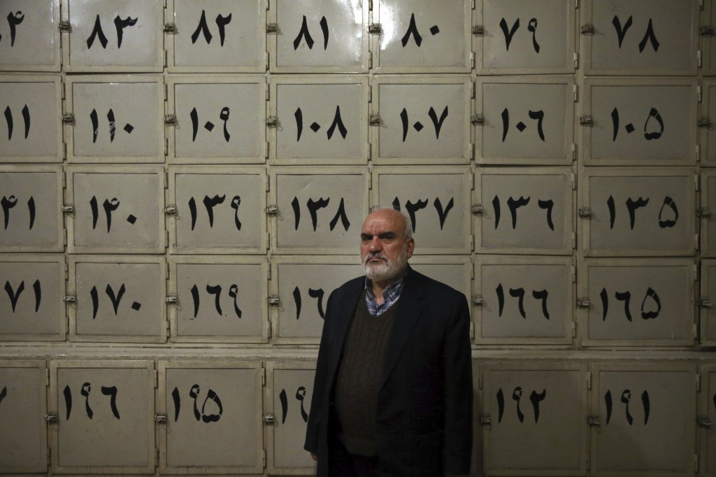 In this Monday, Jan. 7, 2019 photo, Ahmad Sheikhi, a 63-year-old former revolutionary, poses for a photo at a former prison run by the pre-revolution