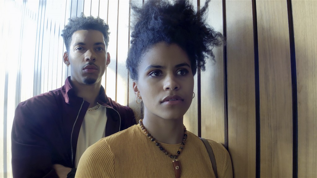"This image released by Netflix shows Melvin Gregg, left, and Zazie Beetz in a scene from ""High Flying Bird."" (Peter Andrews/Netflix via AP)"