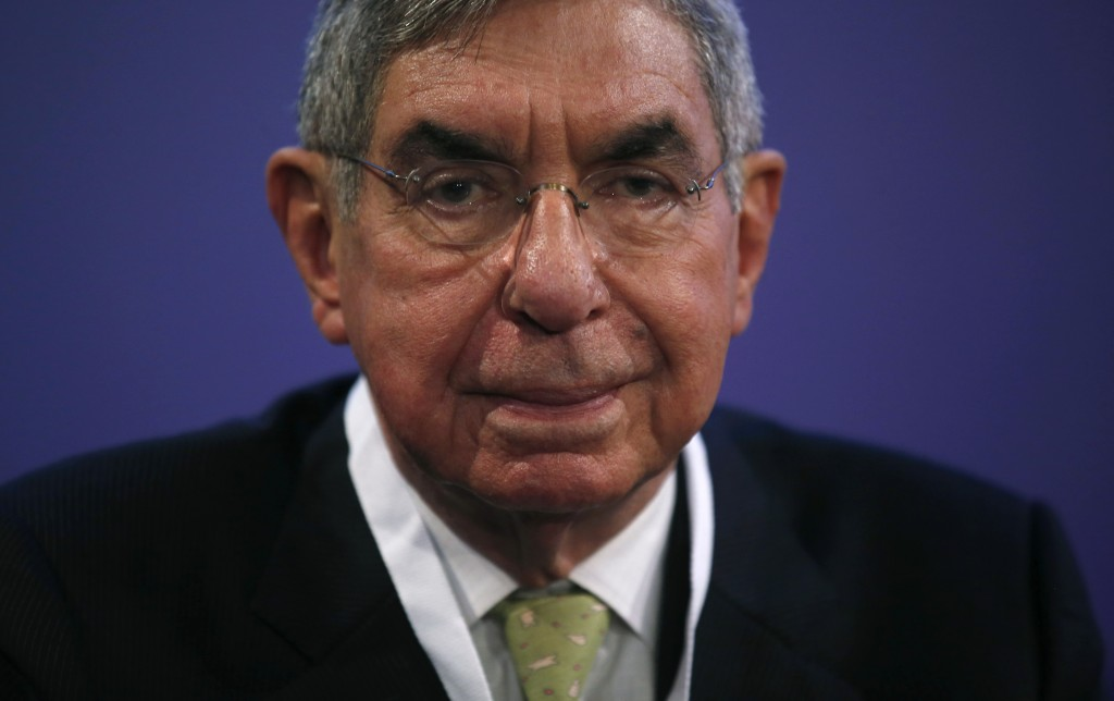 FILE - In this Nov. 13, 2015 file photo, Costa Rican 1987 Nobel peace laureate and former president of Costa Rica, Oscar Arias, looks at the media dur...