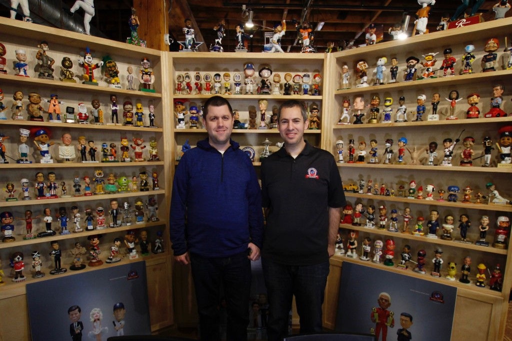 In this Jan. 8, 2019 photo, National Bobblehead Hall of Fame and Museum founders Brad Novak, left, and Phil Sklar, stand near the museum entrance at t