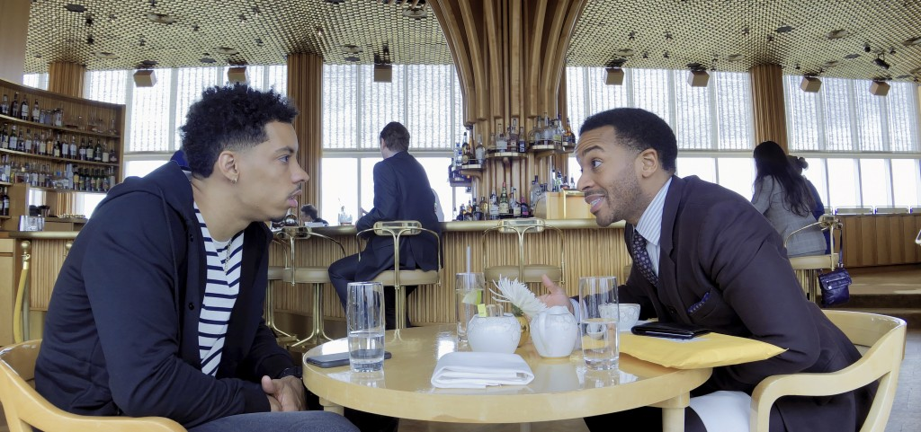 "This image released by Netflix shows Melvin Gregg, left, and André Holland in a scene from ""High Flying Bird."" (Peter Andrews/Netflix via AP)"