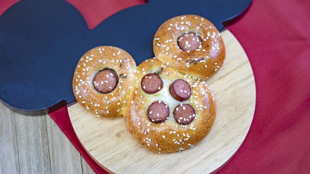 This undated photo provided by Disneyland Resort shows a Mickey Mouse-shaped Chinese hot dog bun from the Prosperity Bao & Buns marketplace at Disney