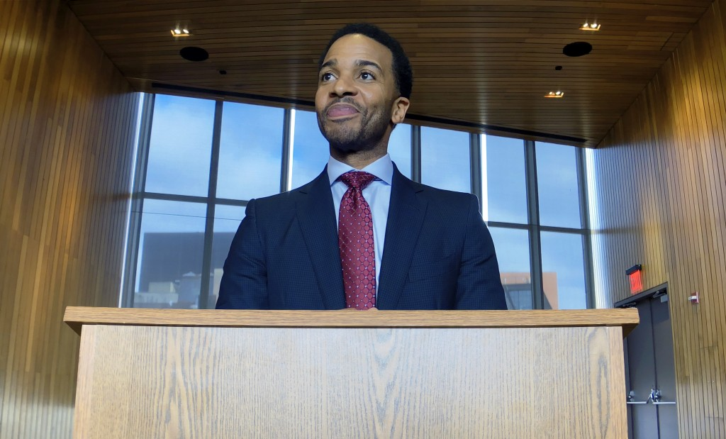 """This image released by Netflix shows André Holland in a scene from """"High Flying Bird."""" (Peter Andrews/Netflix via AP)"""