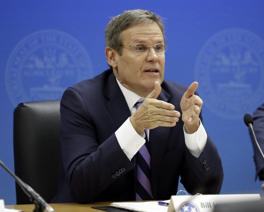 Tennessee Gov. Bill Lee right asks a question on the first day of budget hearings in Nashville Tenn. Lee