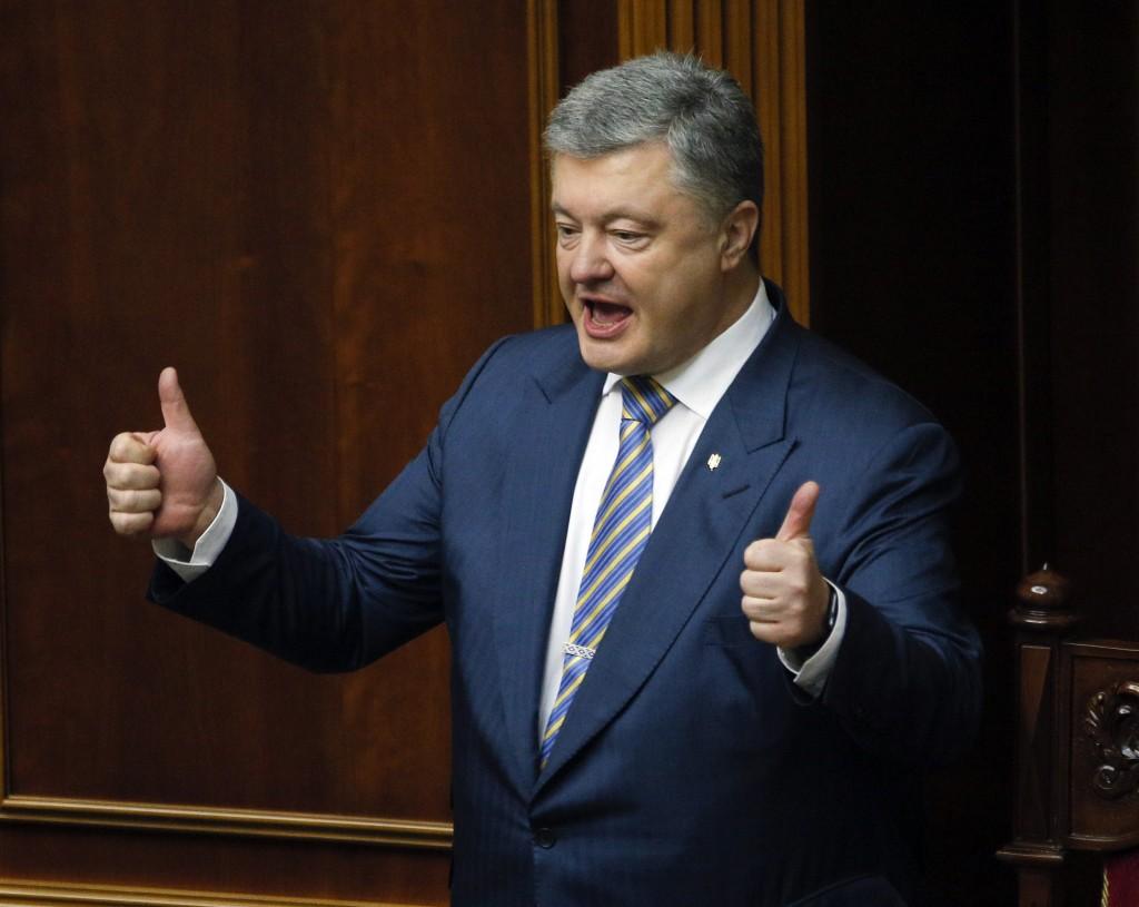 Ukrainian President Petro Poroshenko gestures during a parliament session in Kiev, Ukraine, Thursday, Feb. 7, 2019. During the plenary session the Ukr