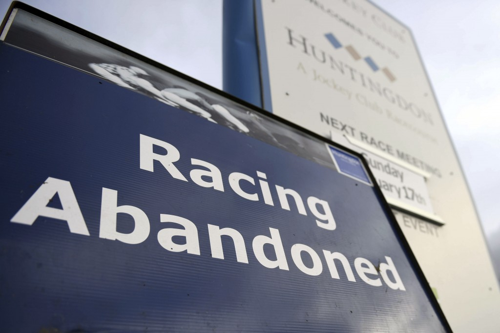 A sign at Huntingdon Racecourse, England, after the racing was abandoned, Thursday Feb. 7, 2019. Horse racing in Britain has been canceled until Wedne...