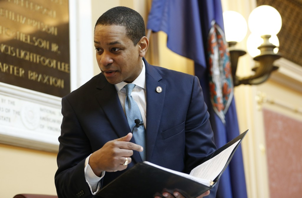 Virginia Lt. Gov Justin Fairfax looks over a briefing book prior to the start of the senate session at the Capitol in Richmond, Va., Thursday, Feb. 7,...