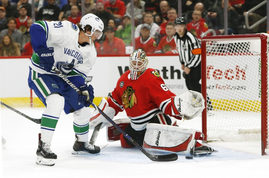 Chicago Blackhawks goaltender Collin Delia (60) stops a shot by Vancouver Canucks left wing Loui Eriksson (21) during the first period of an NHL hocke...