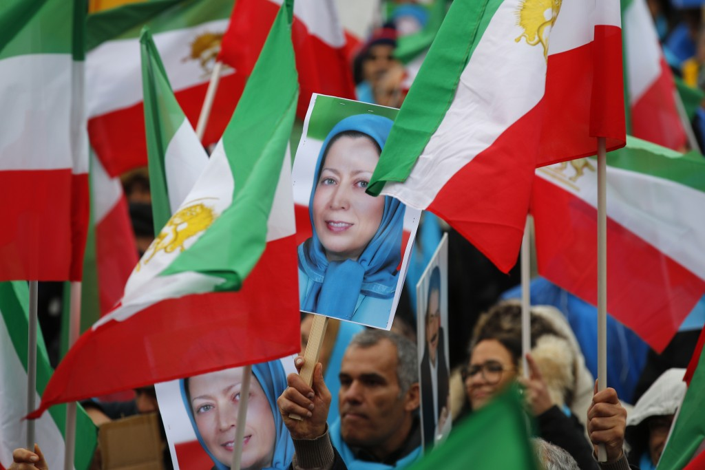 Demonstrators carry posters of Maryam Rajavi, the leader of the National Council of Resistance of Iran, during a protest in Paris, Friday Feb.8, 2019