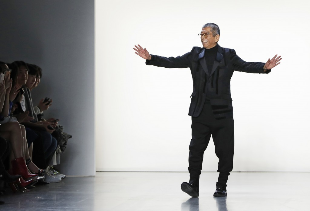 Designer Tadashi Shoji acknowledges his supporters after presenting his fashion collection during New York Fashion Week, Thursday Feb. 7, 2019. (AP Ph