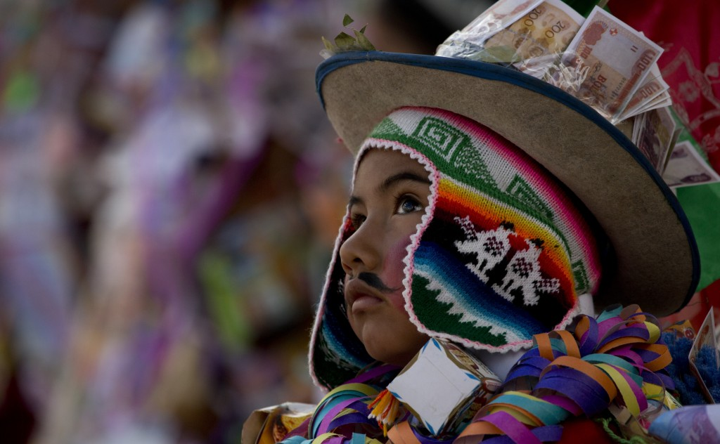 In this Feb. 5, 2019 photo, a child dressed as Ekeko competes at the Alasita miniature fair's Ekeko costume contest in La Paz, Bolivia. Ekeko is often