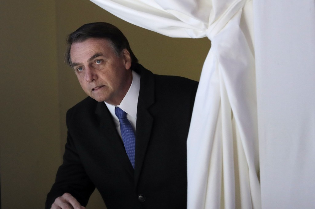 FILE - In this Jan. 22, 2019 file photo, Brazil's President Jair Bolsonaro enters the stage at the World Economic Forum, in Davos, Switzerland. Bolson...