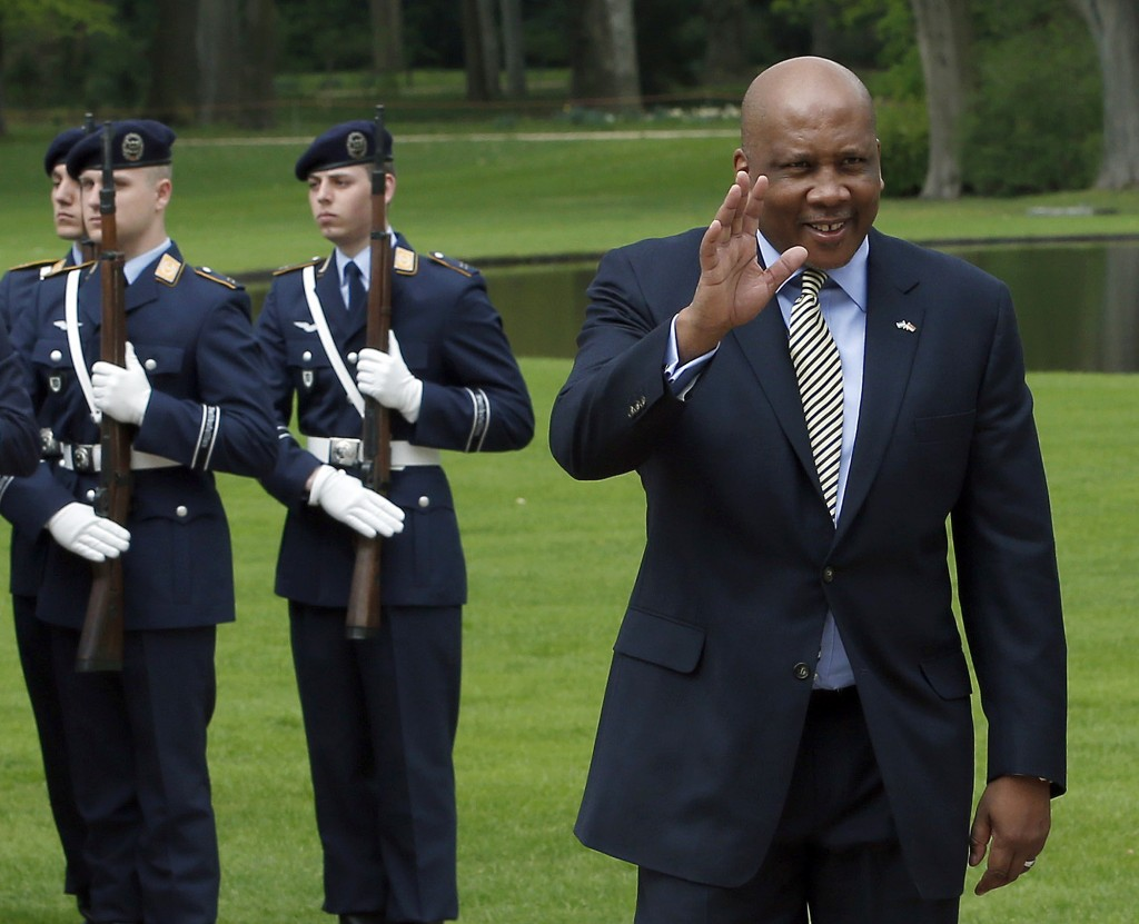 FILE - In this April 29, 2013, file photo, King Letsie III of Lesotho, right, waves in front of military honors at the Bellevue Palace in Berlin, Germ...