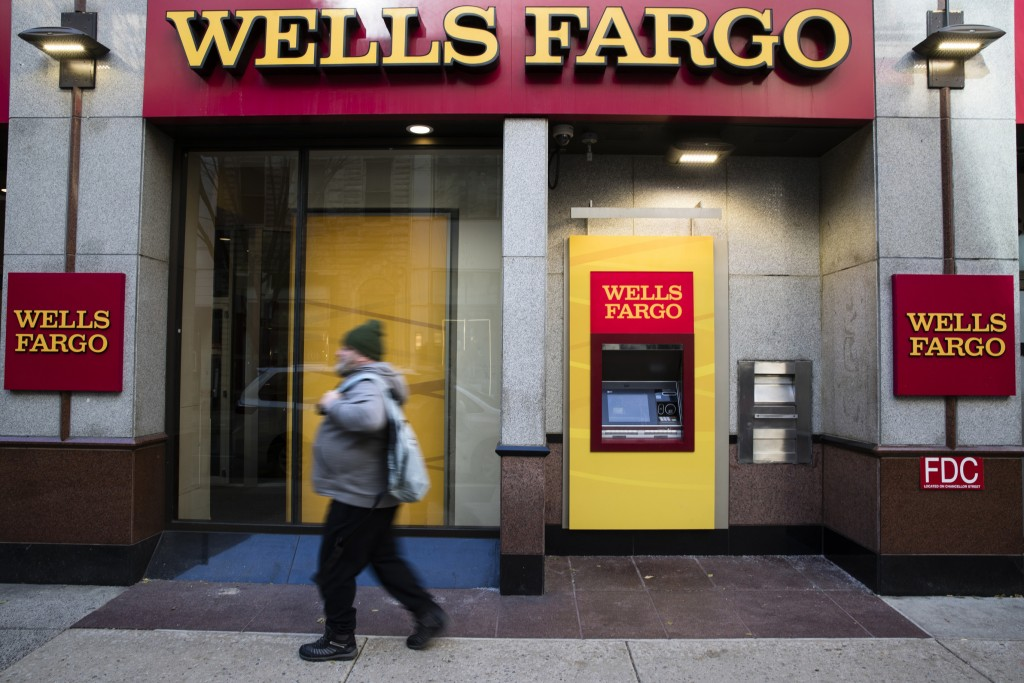 FILE- This Nov. 29, 2018, file photo shows a Wells Fargo bank location in Philadelphia. Wells Fargo customers are experiencing issues with accessing o...