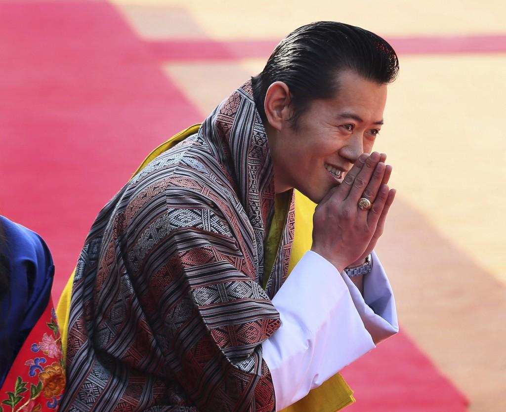FILE - In this Jan. 25, 2013, file photo, Bhutan's King Jigme Khesar Namgyel Wangchuck gestures to Indian President Pranab Mukherjee upon his arrival ...