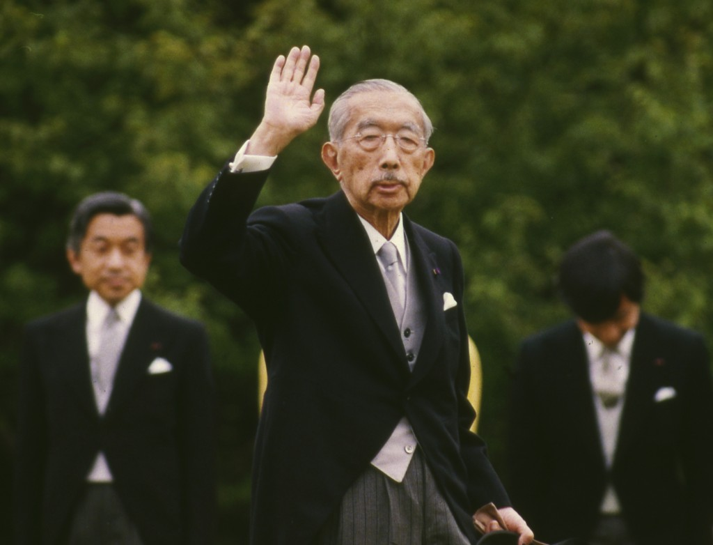 FILE - In this May 19, 1988, file photo, then Japanese Emperor Hirohito waves as Crown Prince Akihito, left, looks on during an imperial garden party ...