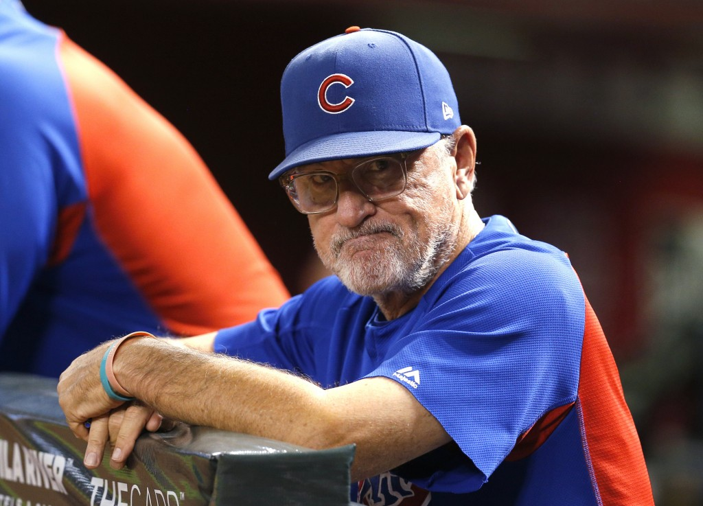 FILE - In this Sept. 18, 2018, file photo, Chicago Cubs manager Joe Maddon stands at the rail during the first inning of the team's baseball game agai