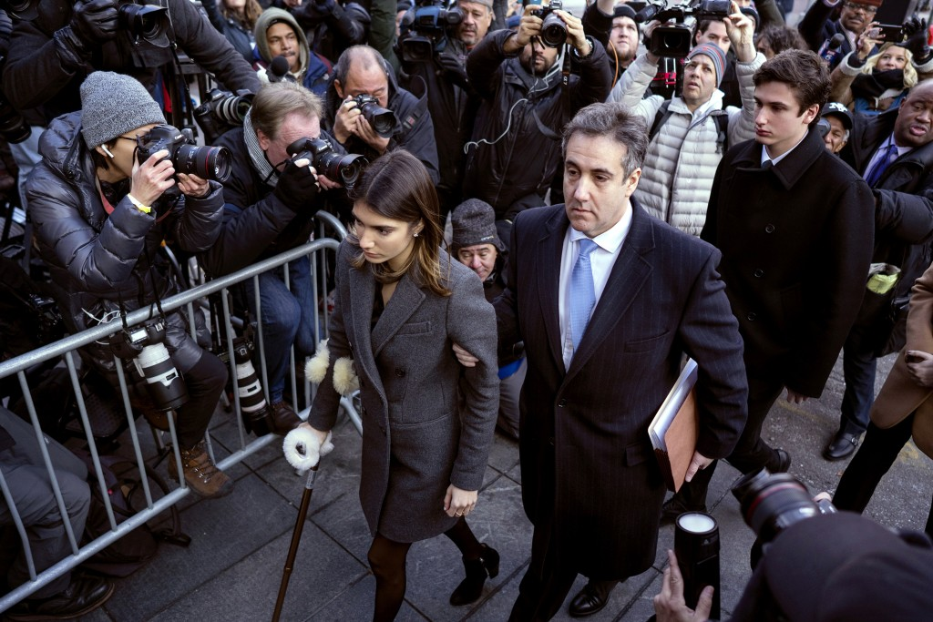FILE - In this Dec. 12, 2018, file photo, Michael Cohen, center, President Donald Trump's former lawyer, accompanied by his children Samantha, left, a...