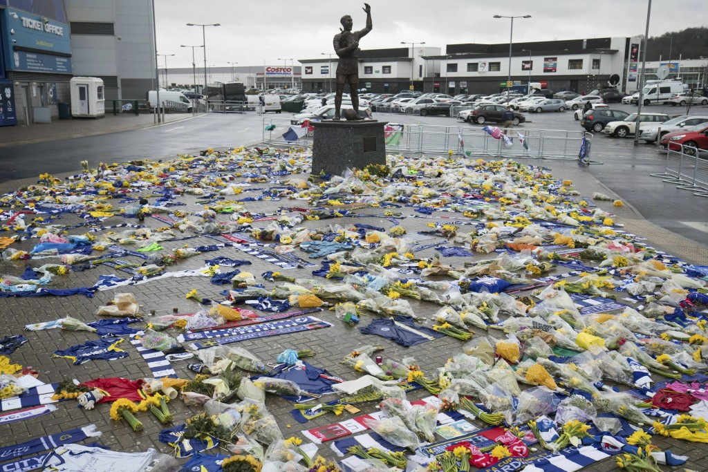 Tributes are placed outside the Cardiff City Stadium, Wales, for Emiliano Sala, Friday Feb. 8, 2019. Tributes are being paid across soccer to Argentin