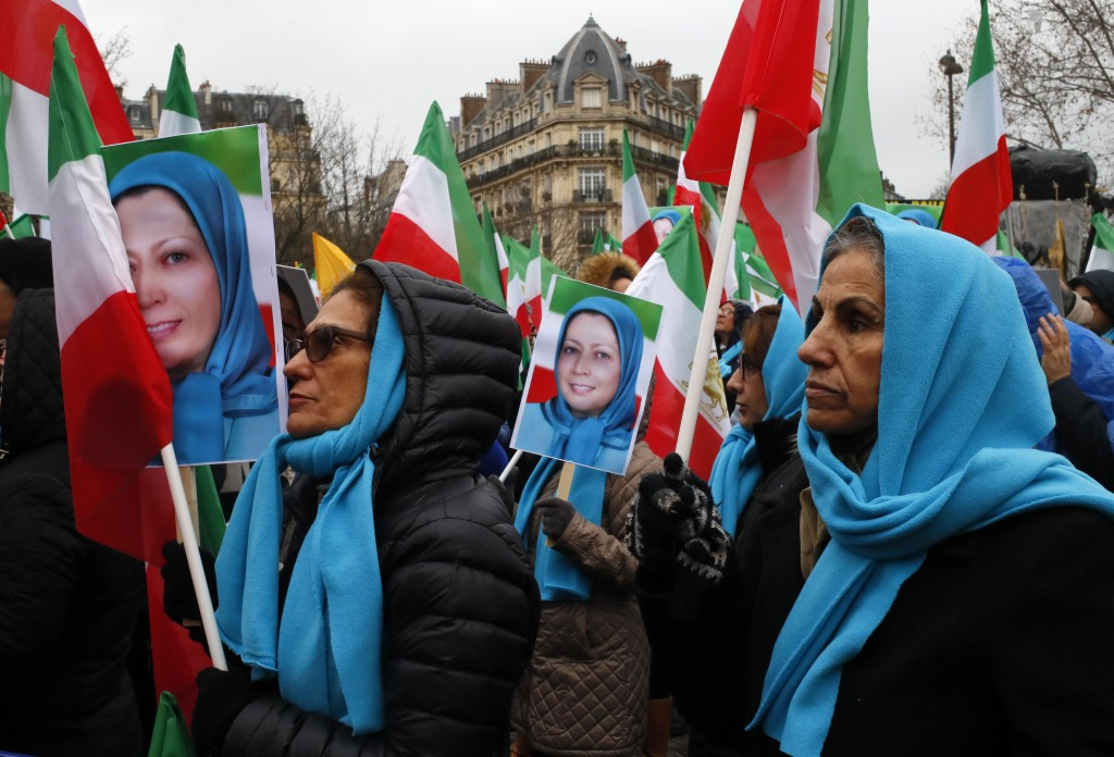 Demosntrators carry posters of Maryam Rajavi, the leader of the National Council of Resistance of Iran, during a protest in Paris, Friday Feb.8, 2019